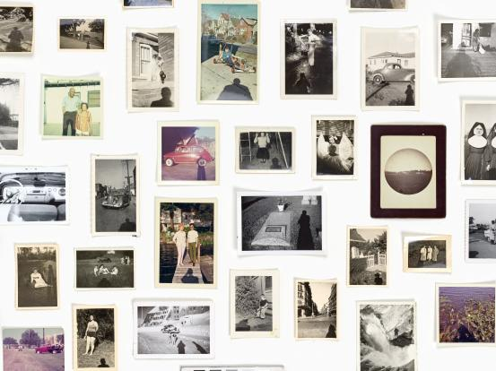 A wall with several polaroid style photos pinned to it, various content including: cars, nuns, people