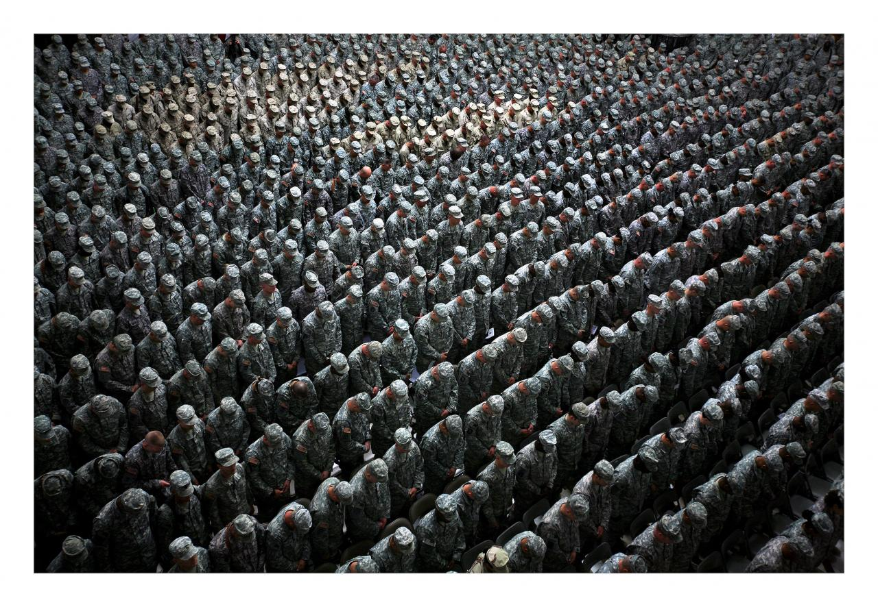 Ashley Gilbertson 1,215 American soldiers, airmen, Marines and sailors pray before a pledge of enlistment on July 4, 2008, at a massive re-enlistment ceremony at one of Saddam Hussein's former palaces in Baghdad, Iraq. From the series Whiskey Tango Foxtrot 2008