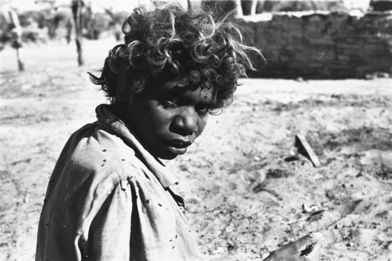 Aboriginal station girl, seed gathering