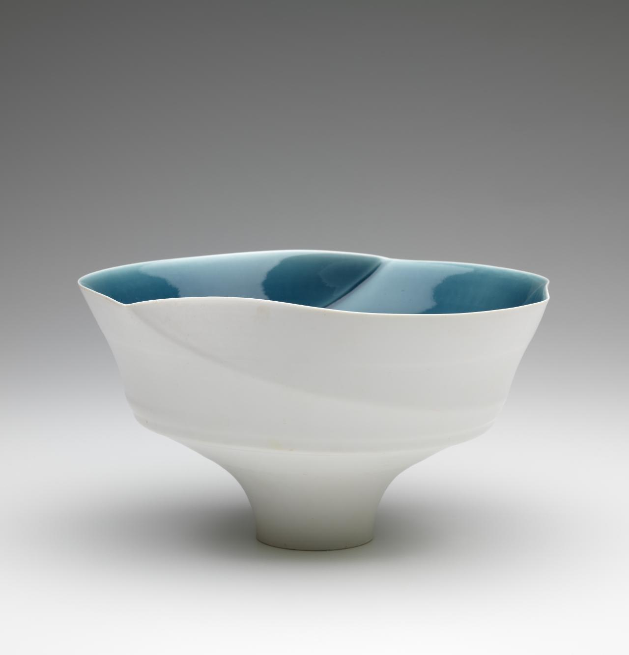 Spiral lip bowl with blue interior glaze