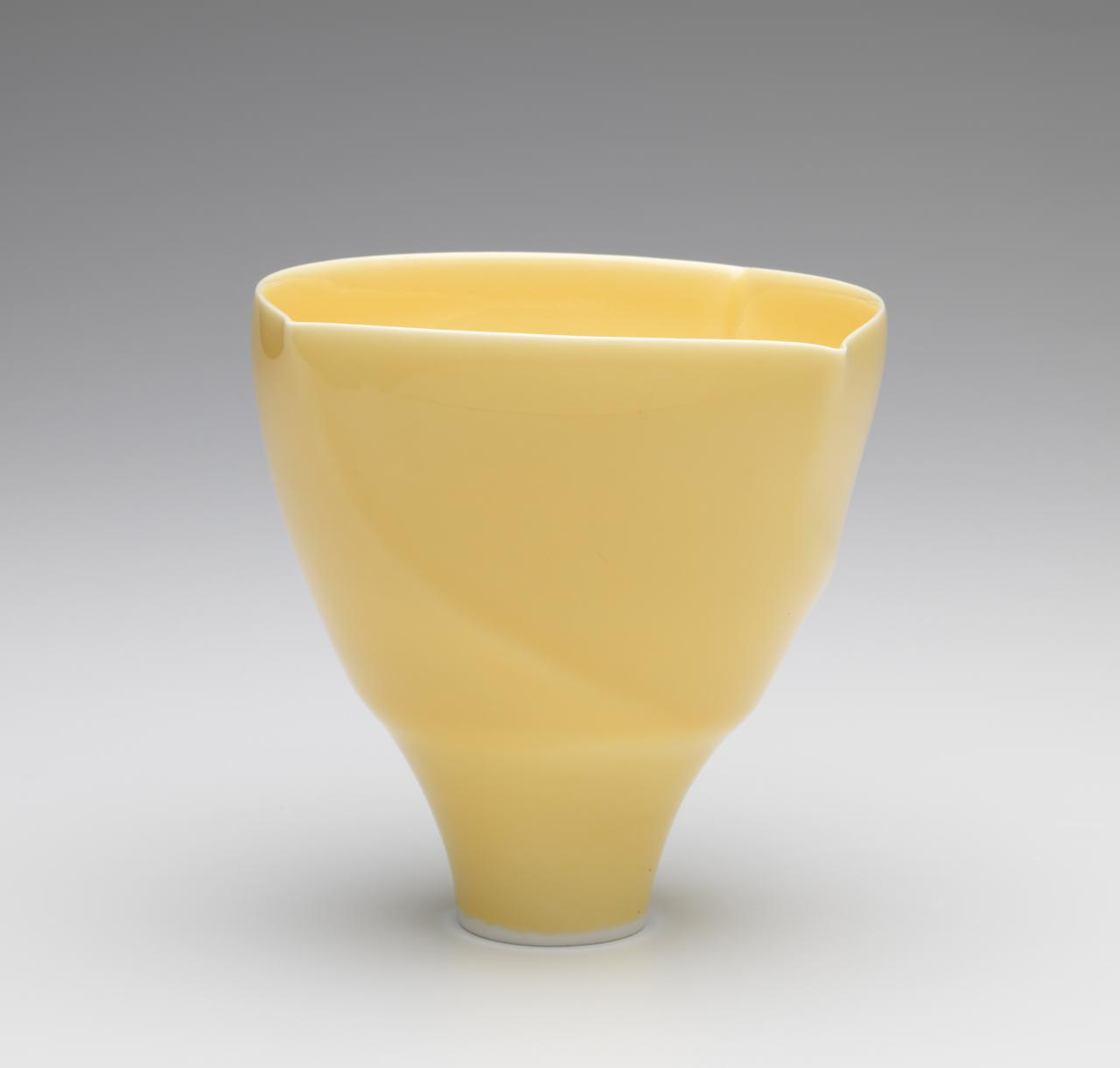 Yellow glazed spiral form bowl