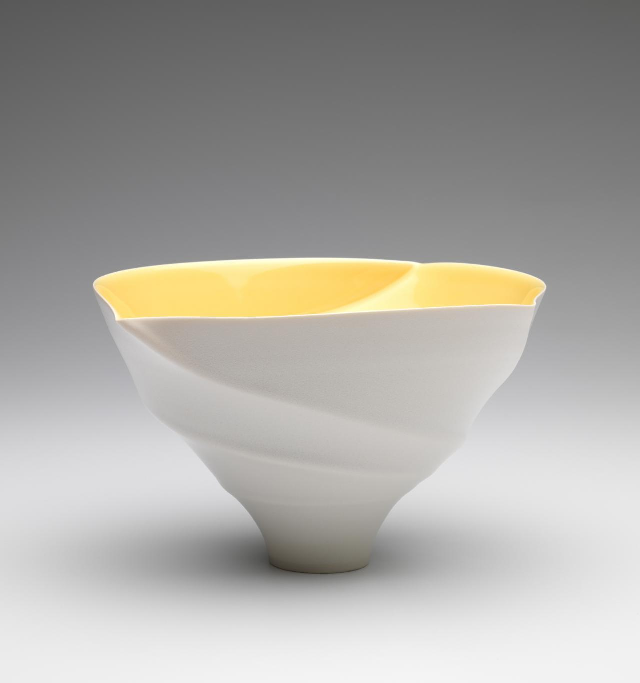 Spiral lipped bowl with yellow interior glaze