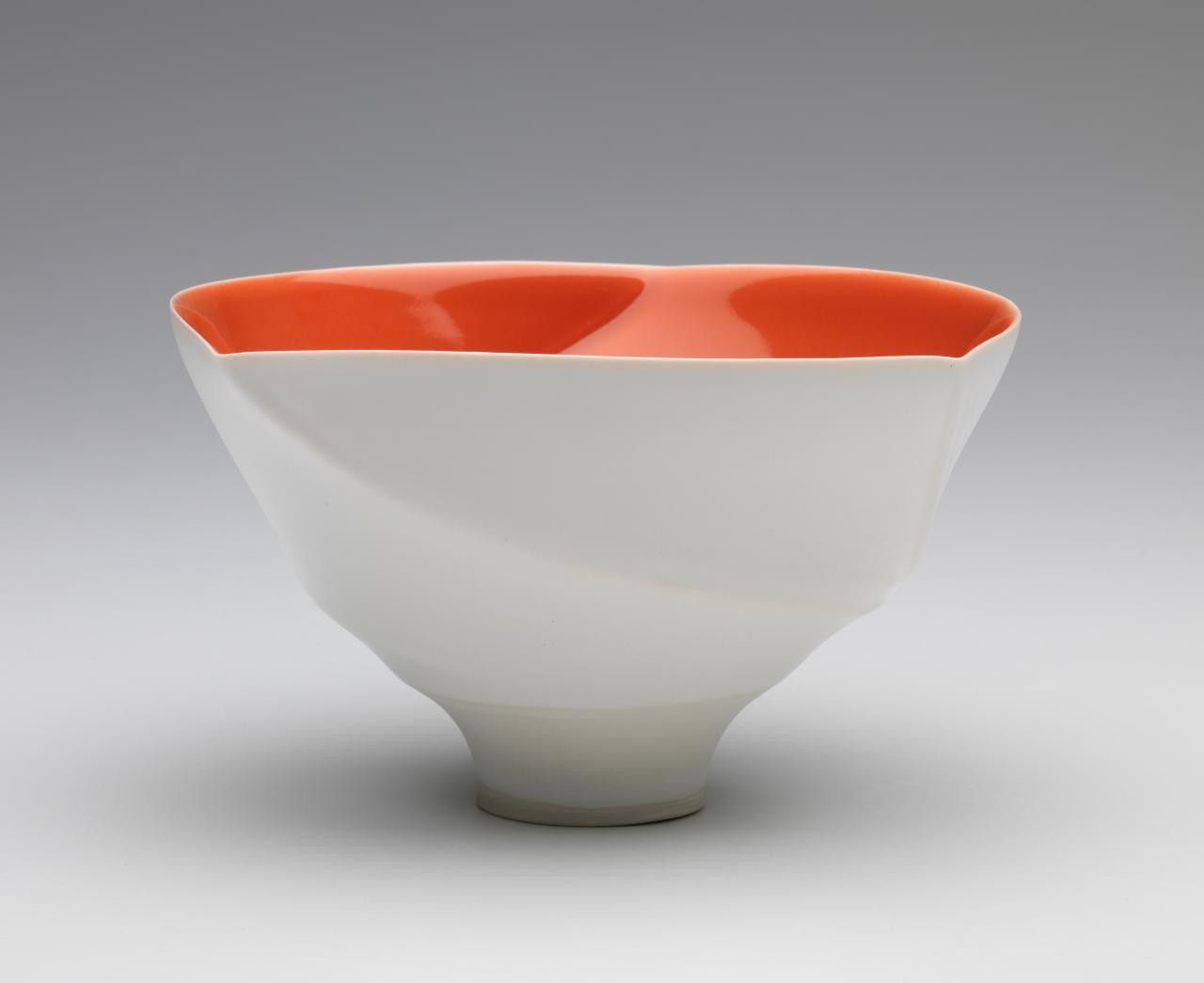 Spiral lipped bowl with orange/red interior glaze