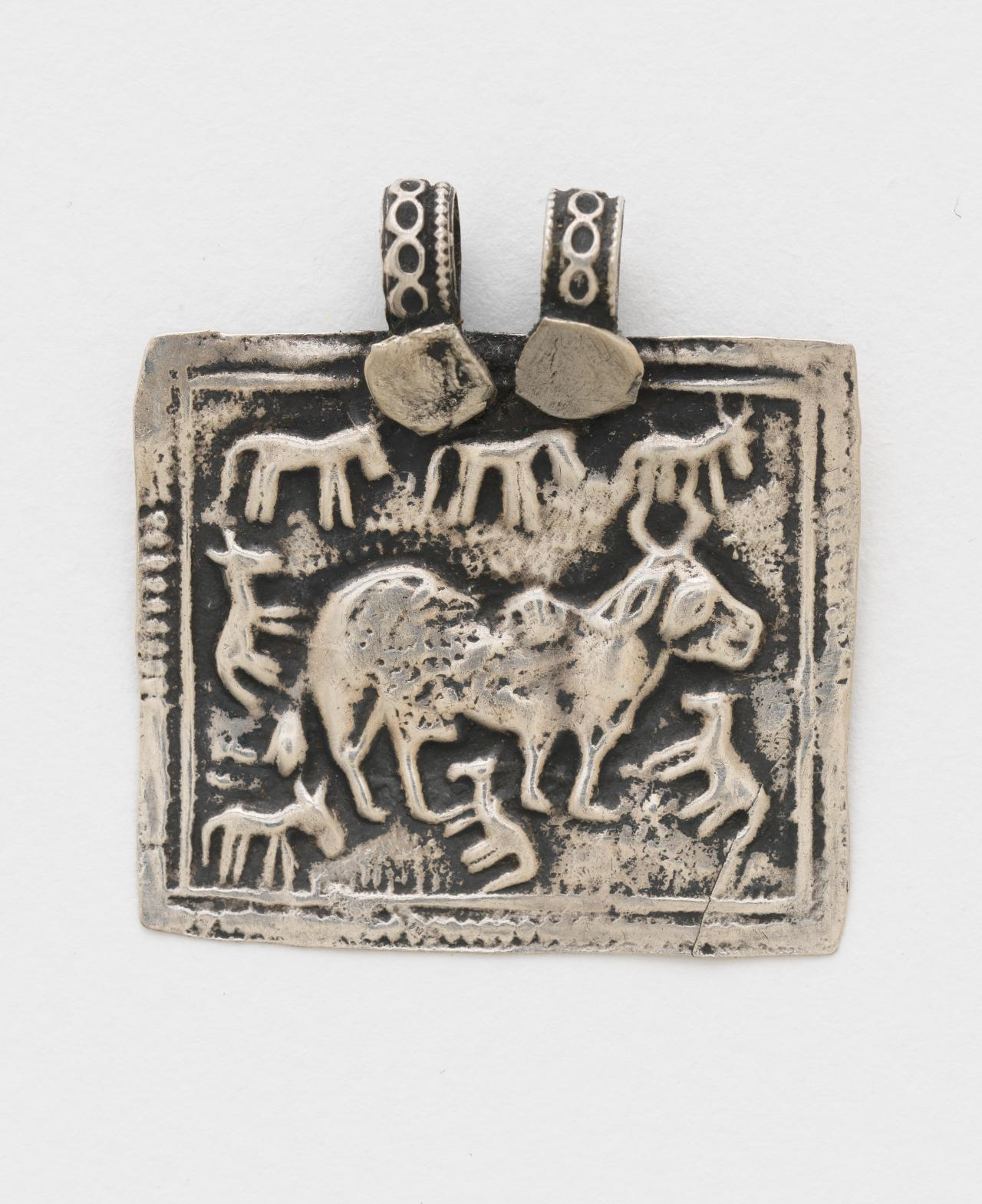 Pilgrimage and devotional pendant (Phul) with cow and calves