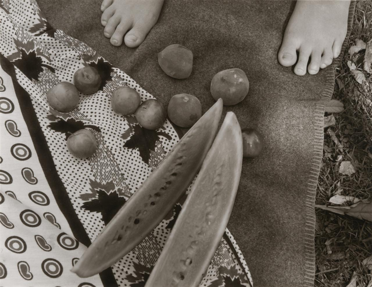 No title (child's feet and fruit)