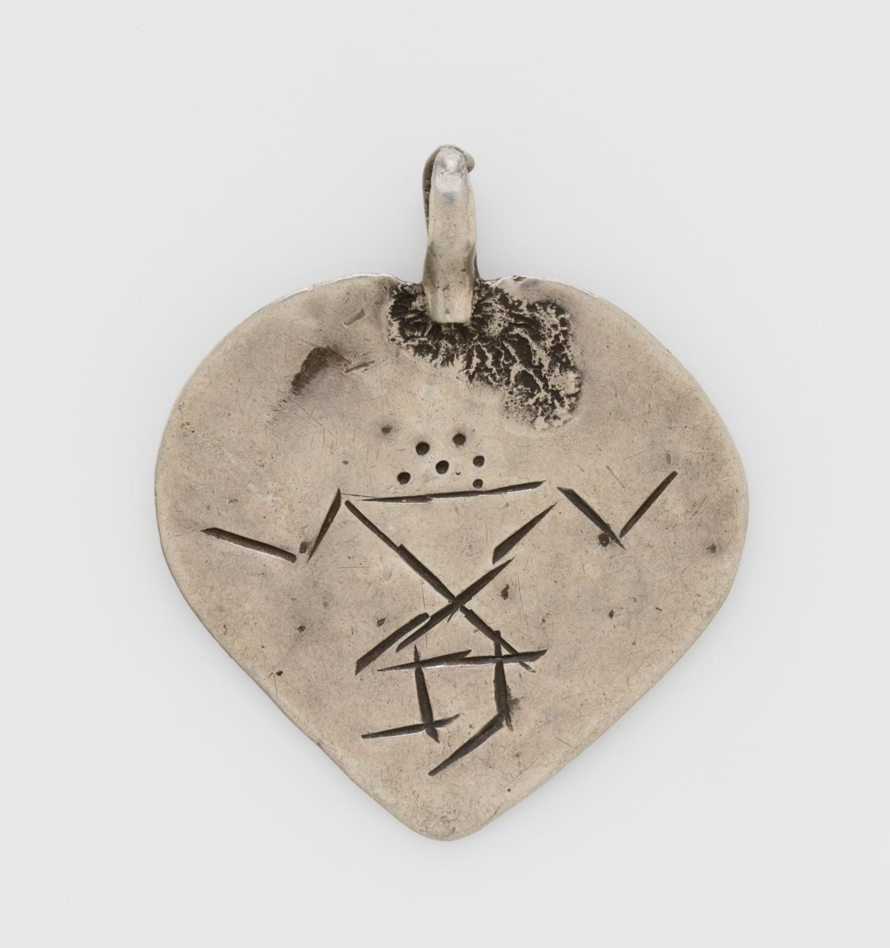 Pilgrimage and devotional pendant (Phul) with mother figure