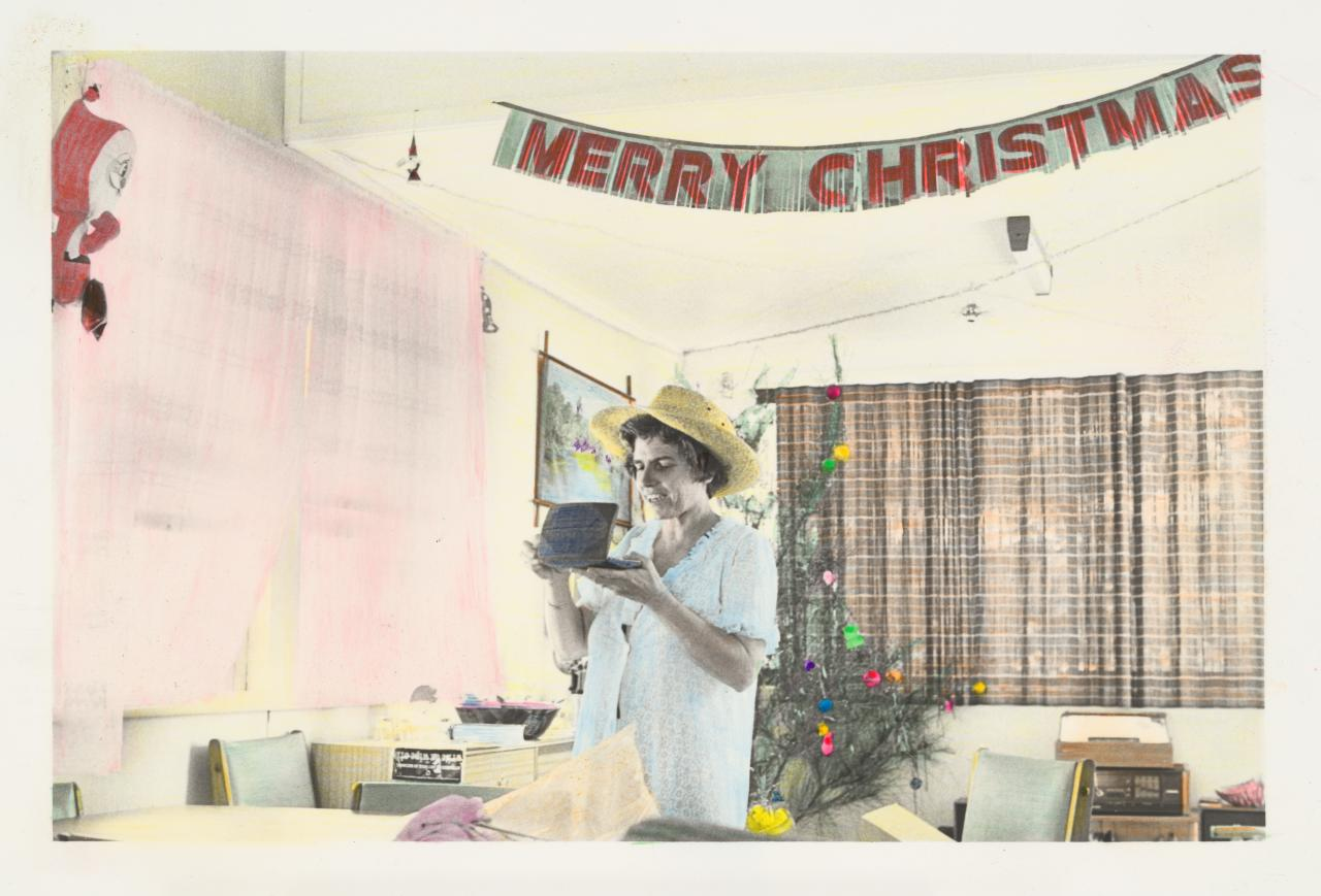 No title (Woman unwrapping Christmas presents)