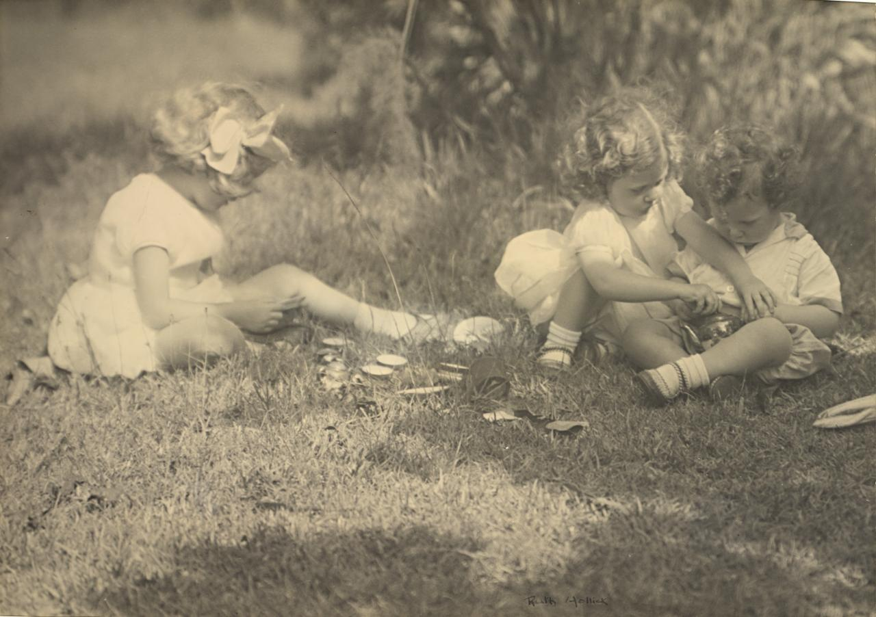No title (Three children seated on grass)