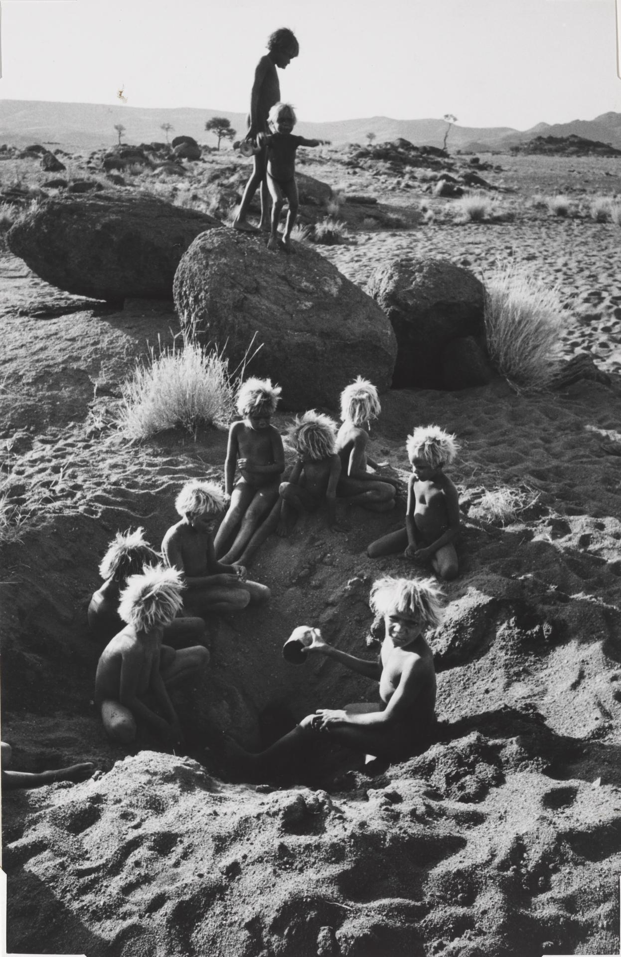 Aboriginal children digging for water