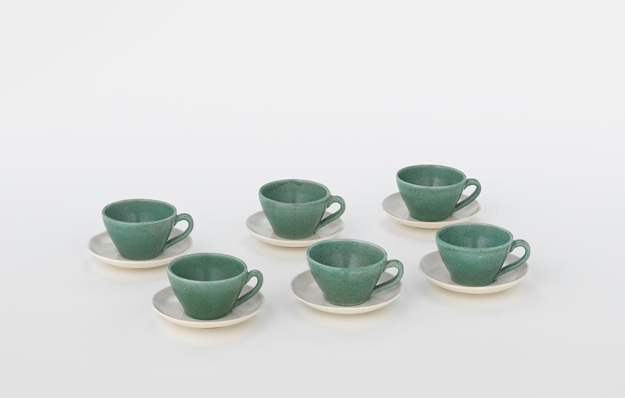 Six cups with saucers