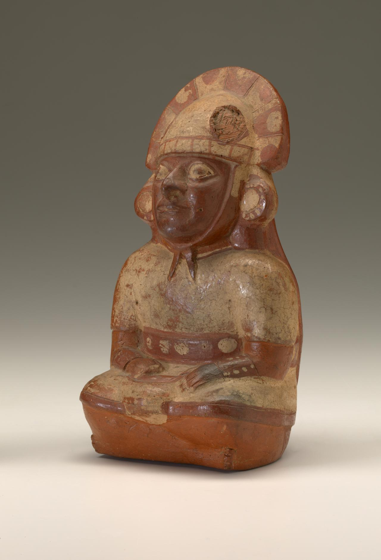Seated figure, vessel