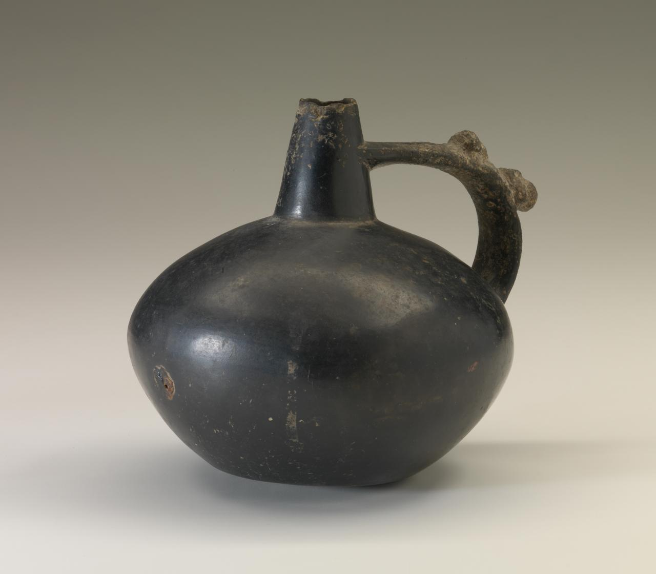 Strap-handled bottle