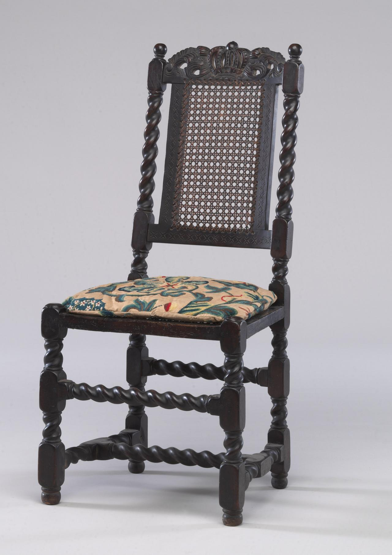 Chair with embroidered cushion