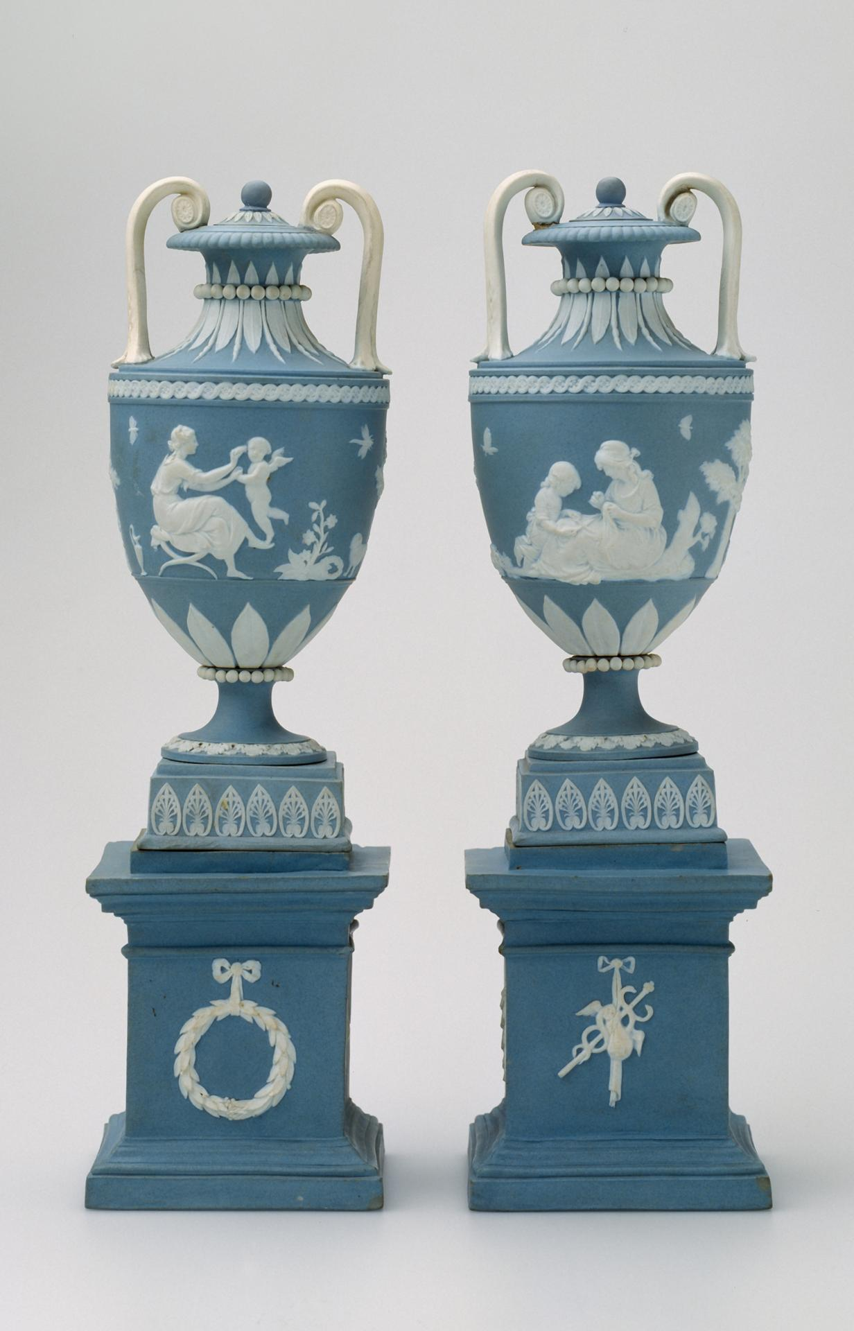 Pair of covered vases and pedestals