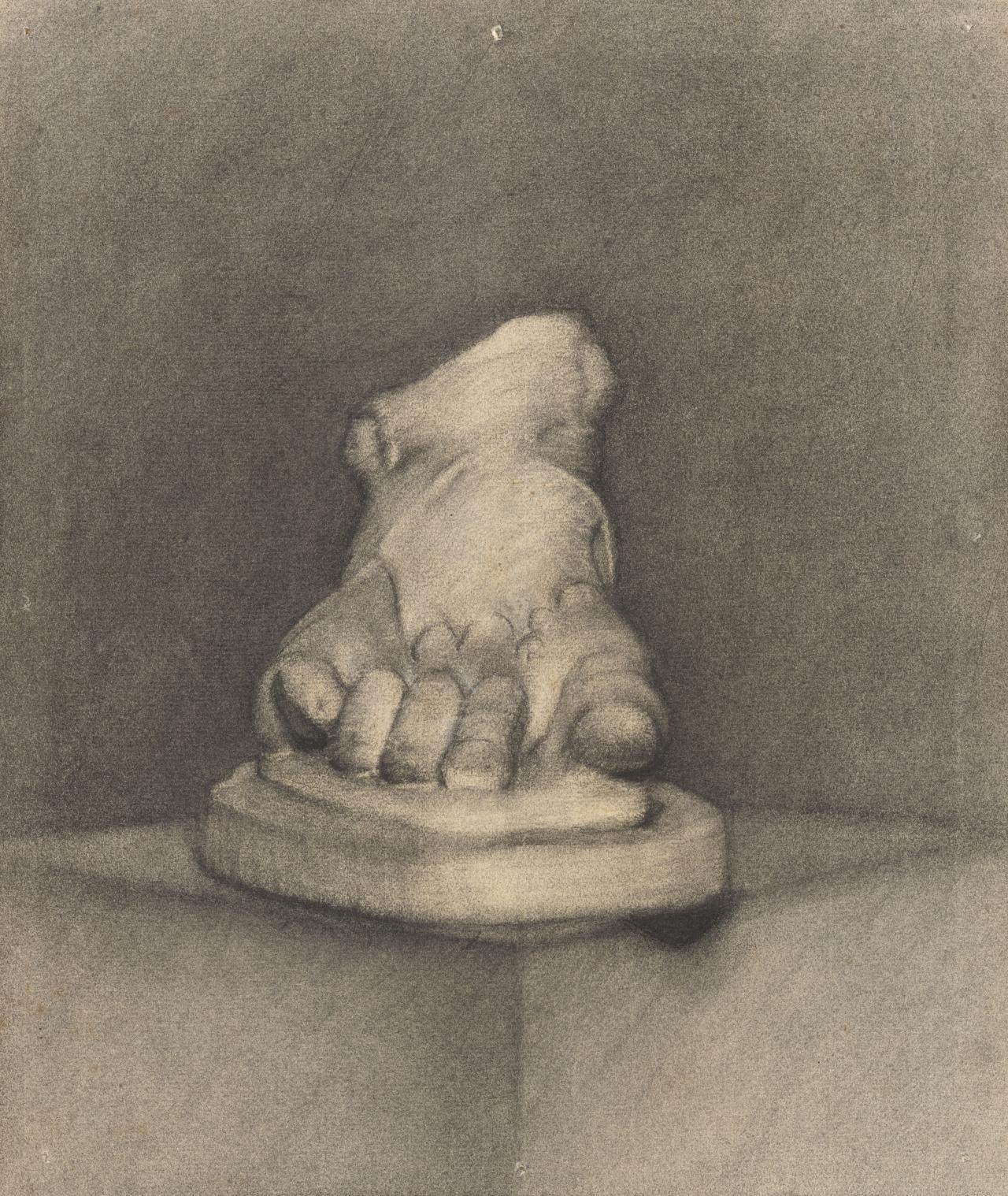 Plaster foot on stand on pedestal