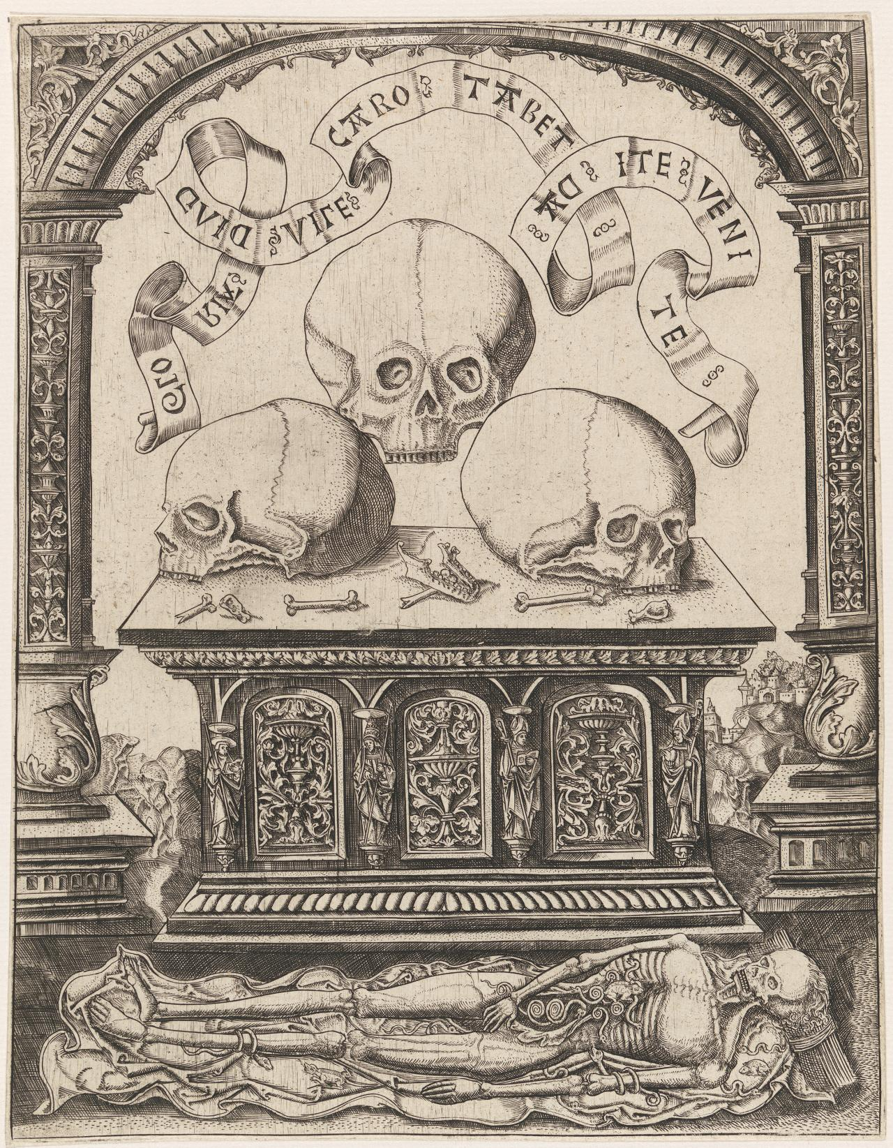 Three skulls on a carved tomb