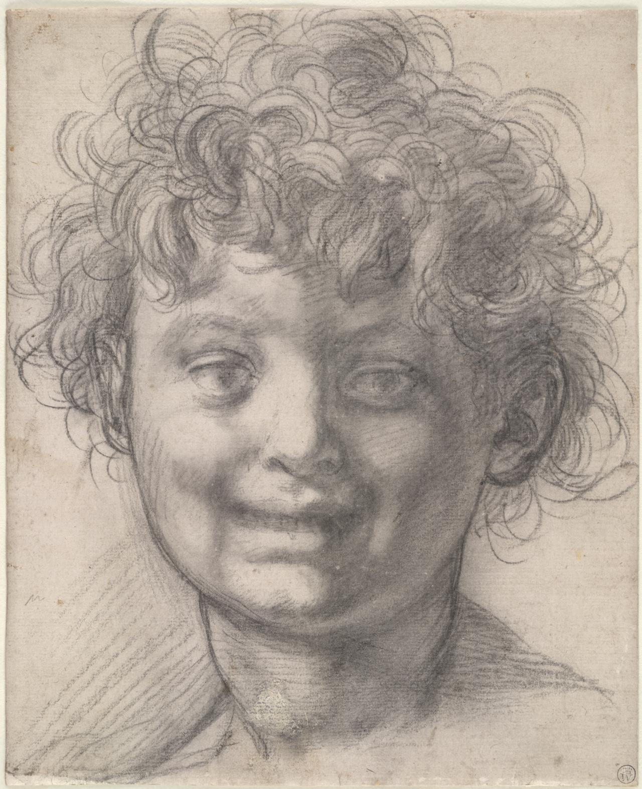 Head of a laughing boy