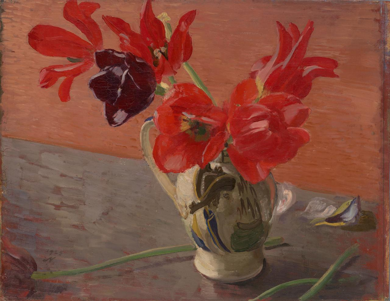 Red tulips in a china jug