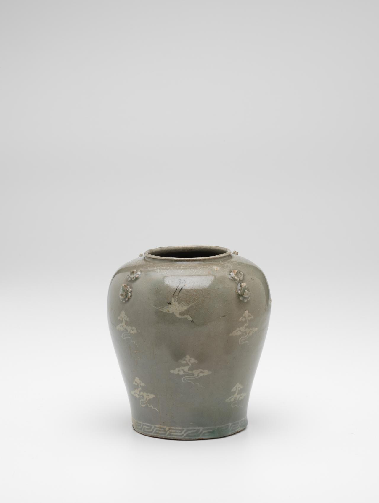 Jar with inlaid crane and cloud design