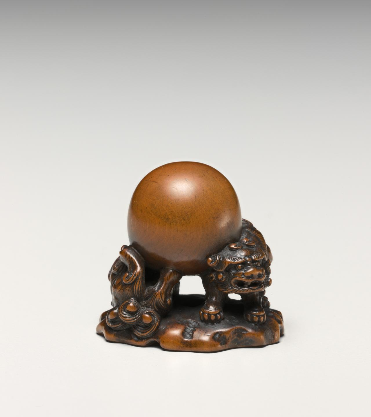 Lions and ball, netsuke
