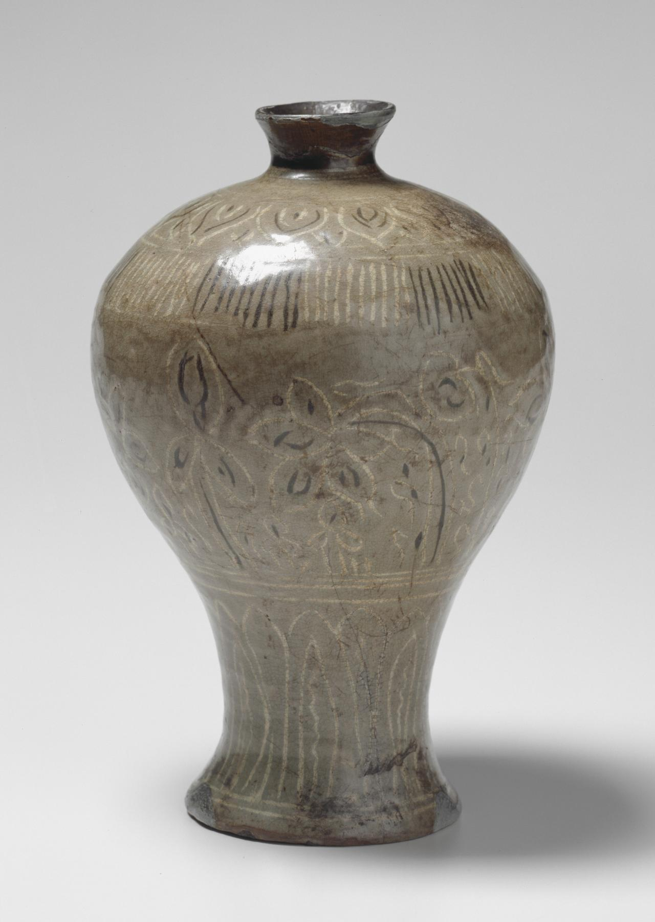 Vase with inlay floral design