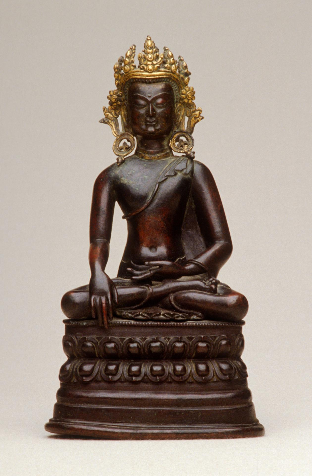 Crowned Buddha calling the Earth to witness