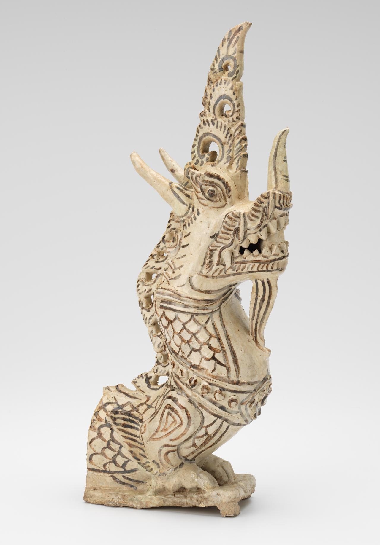 Roof finial in the form of a makara