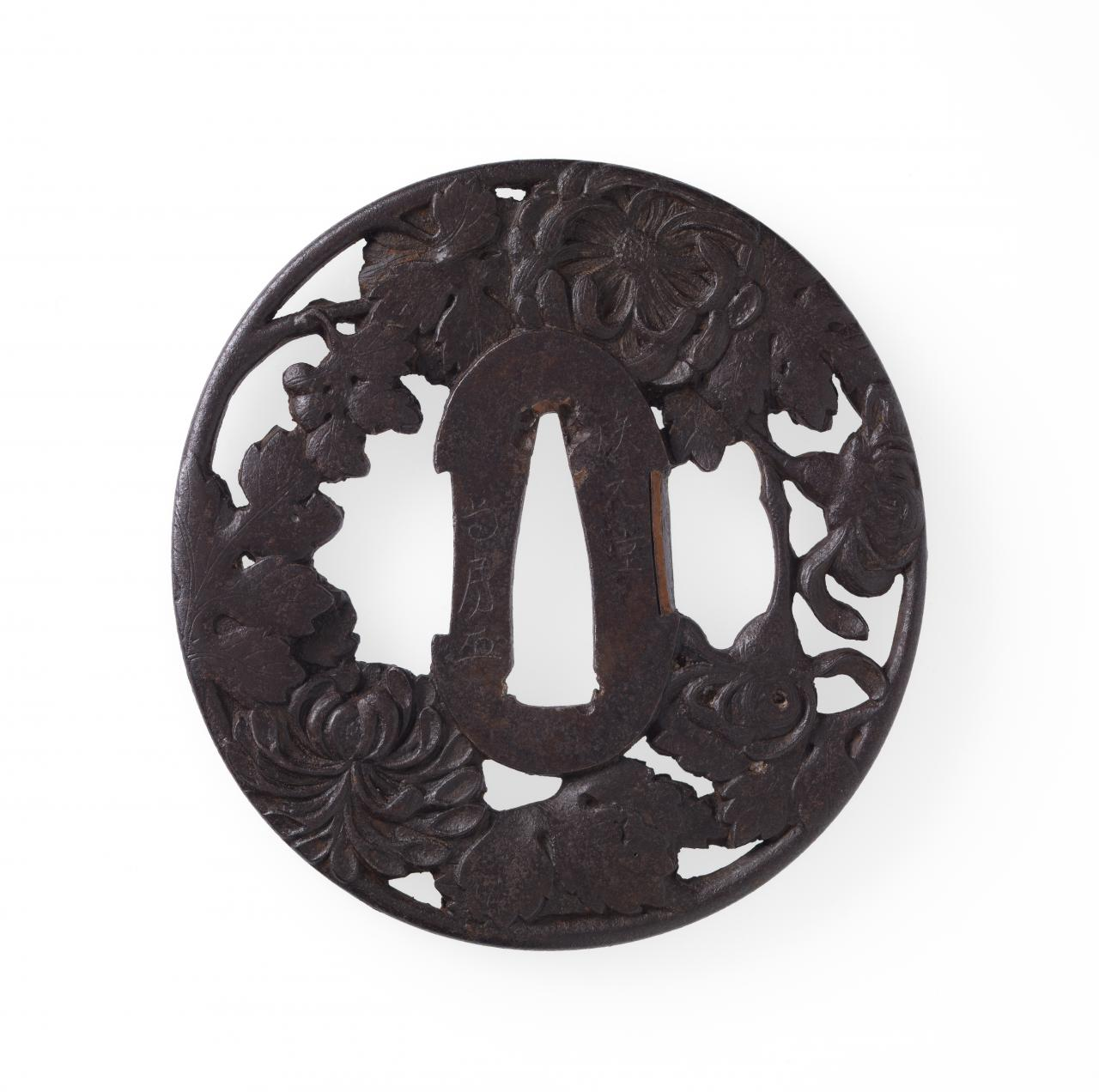 Sword guard with chrysanthemum design