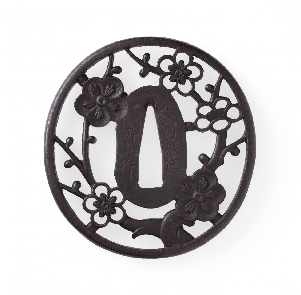 Sword guard with plum tree design