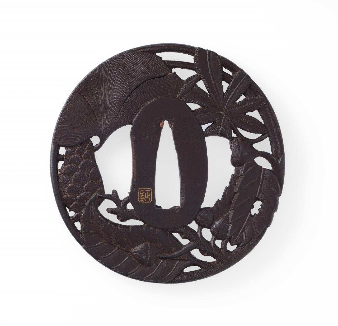 Sword guard with autumn leaves design