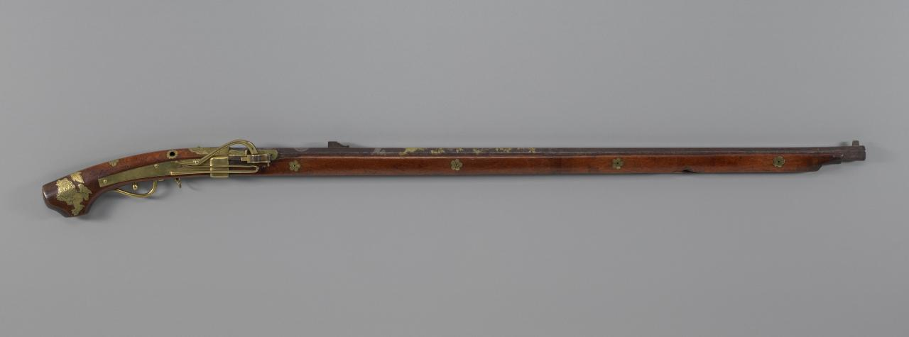Matchlock gun with lion dog and peony design