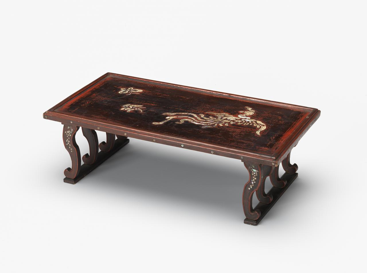 Table with phoenix, butterflies and eight legs