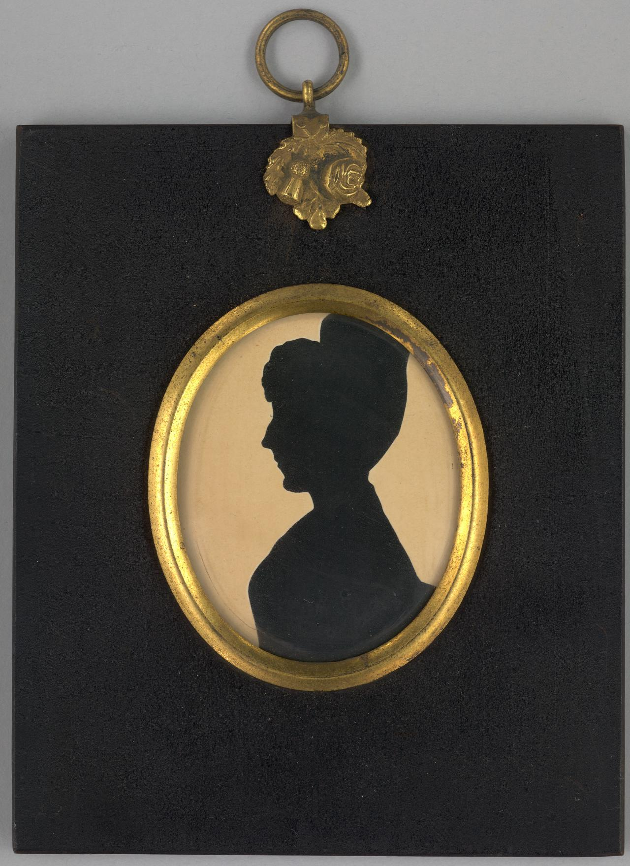 Silhouette portrait of a woman in high-necked bodice, her hair in a high chignon, facing left