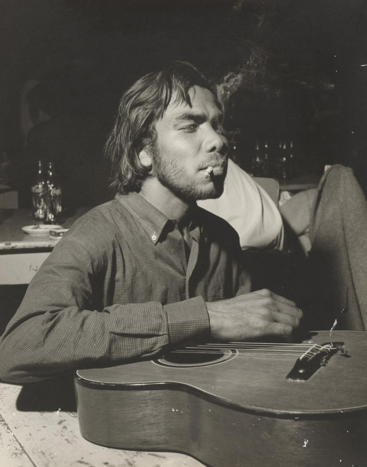 No title (Hernando's Hideaway, young man smoking with guitar)