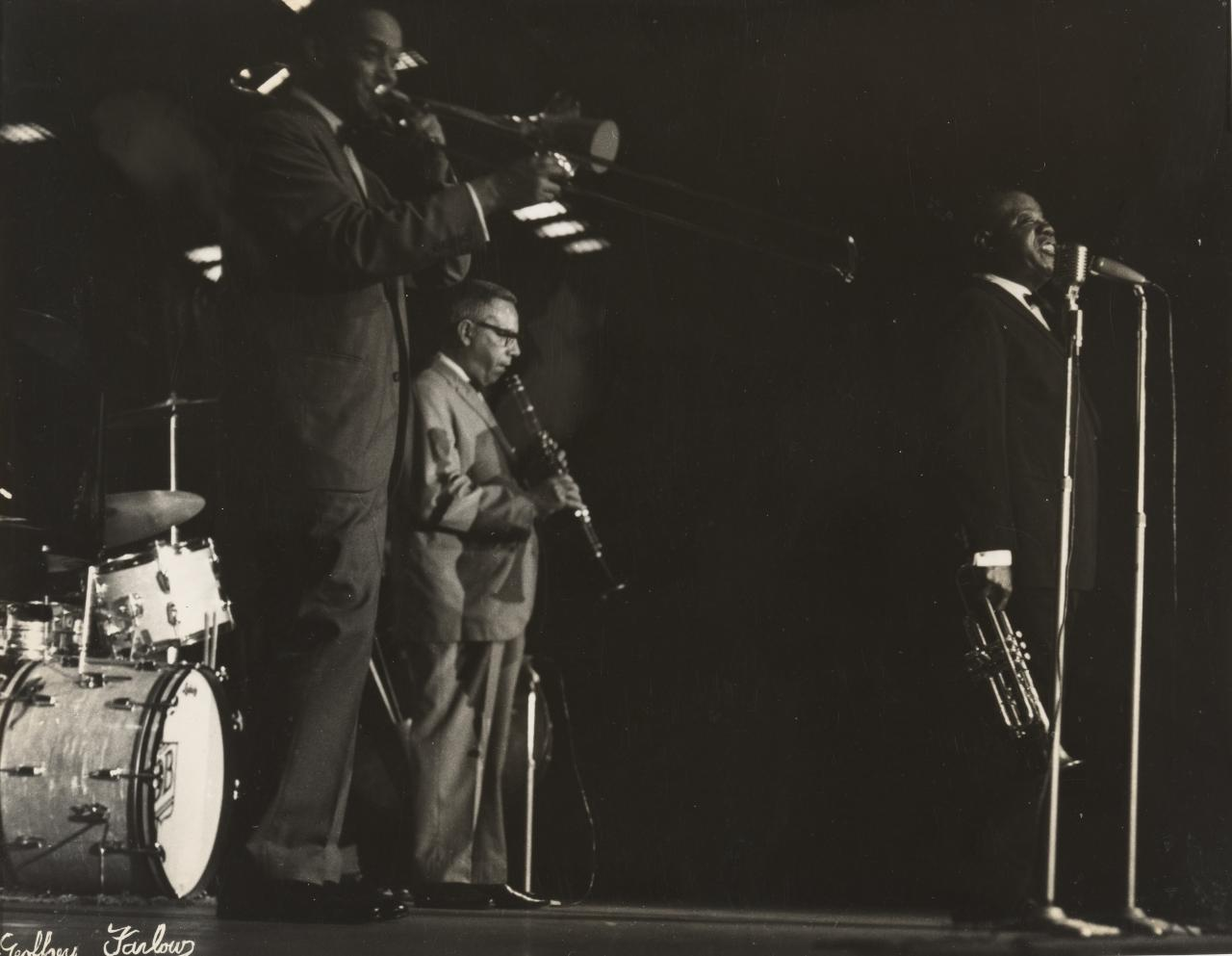 No title (Louis Armstrong concert, Armstrong at microphone)