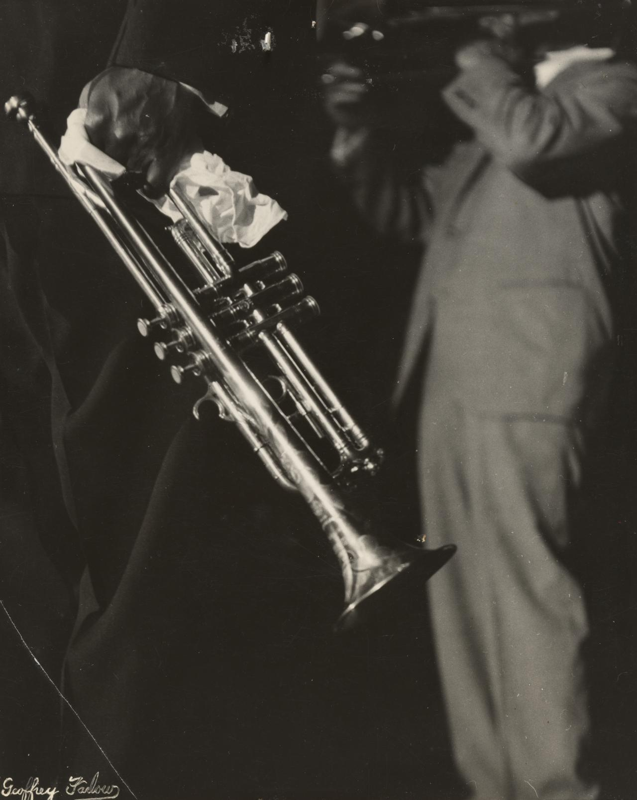 No title (Louis Armstrong concert, hand holding trumpet)