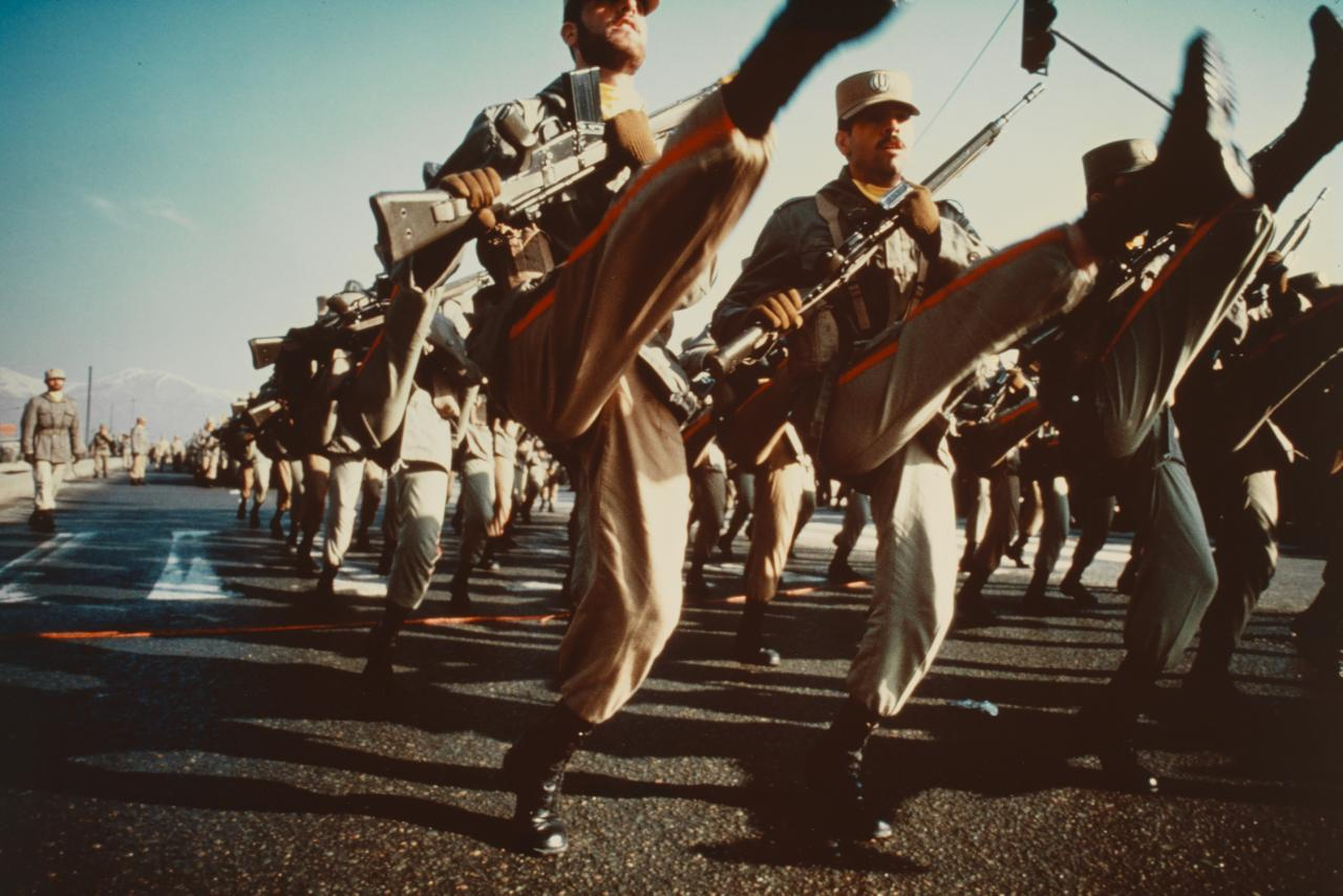 Iranian soldiers bearing German G-3 rifles goose-step through Tehran during a parade commemorating the anniversary of the day Ayatollah Khomeini took power