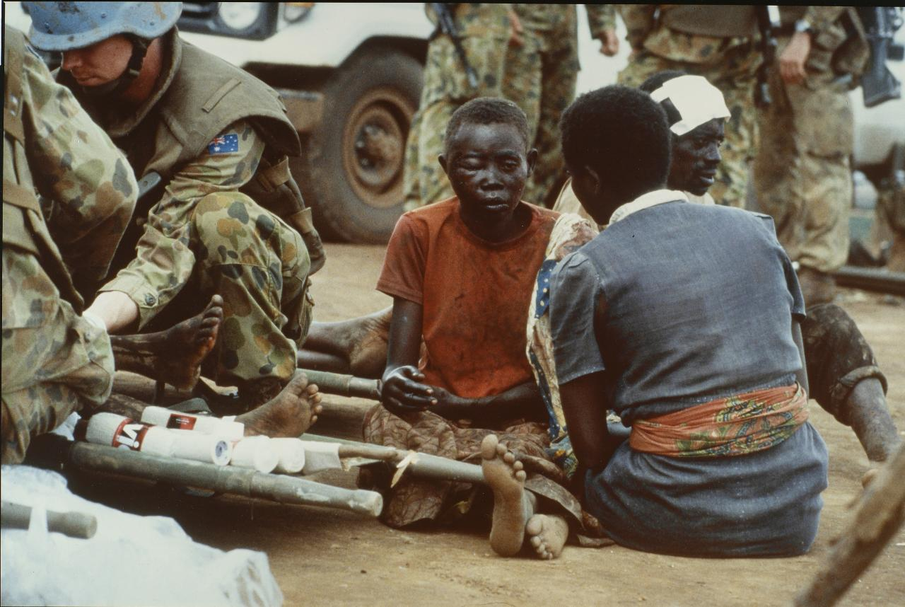 The dazed. Wounded Hutu refugees being protected and treated by the Australian Army medical unit at Kibeho camp