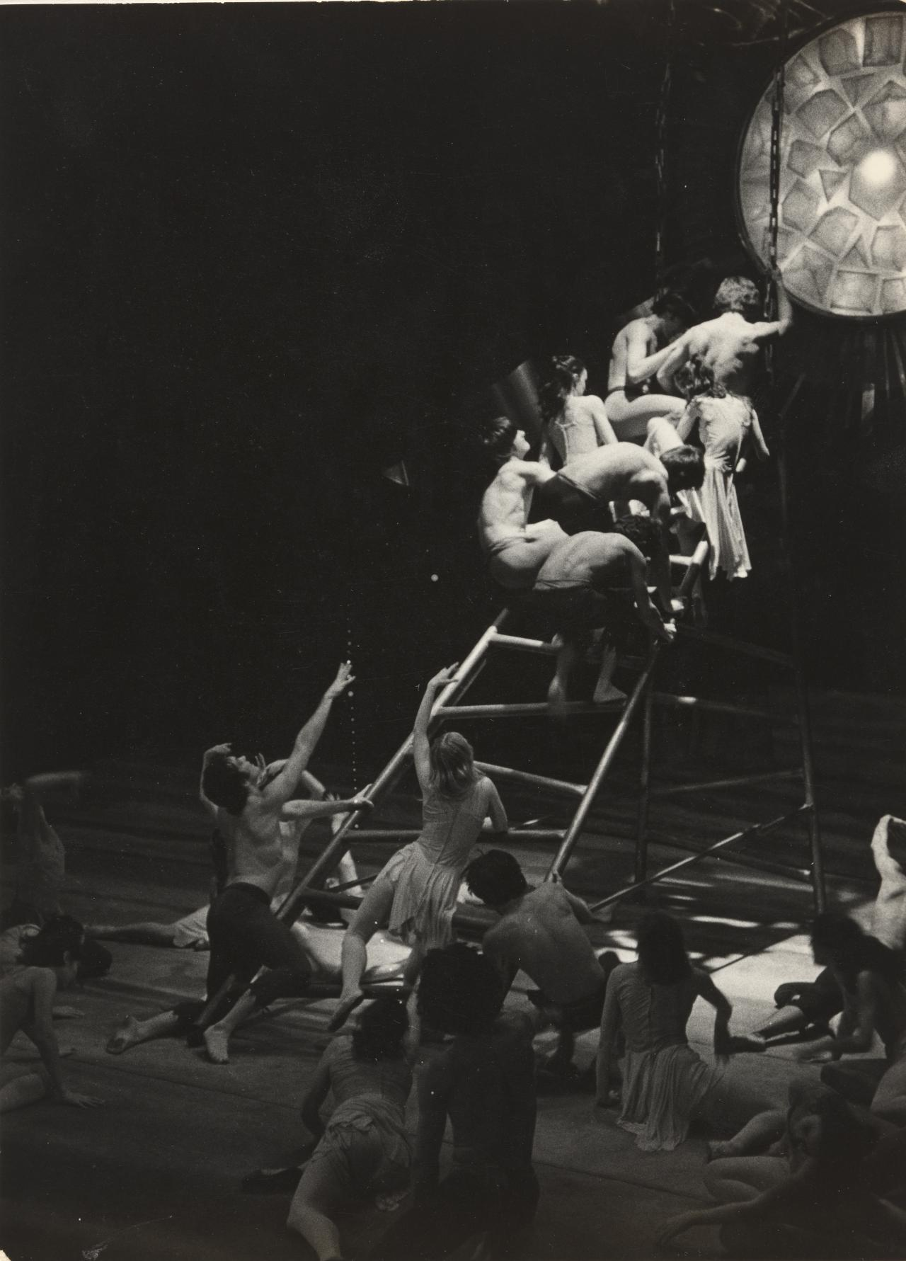 No title (Theatre illustration. Dancers huddled at top of ladder)