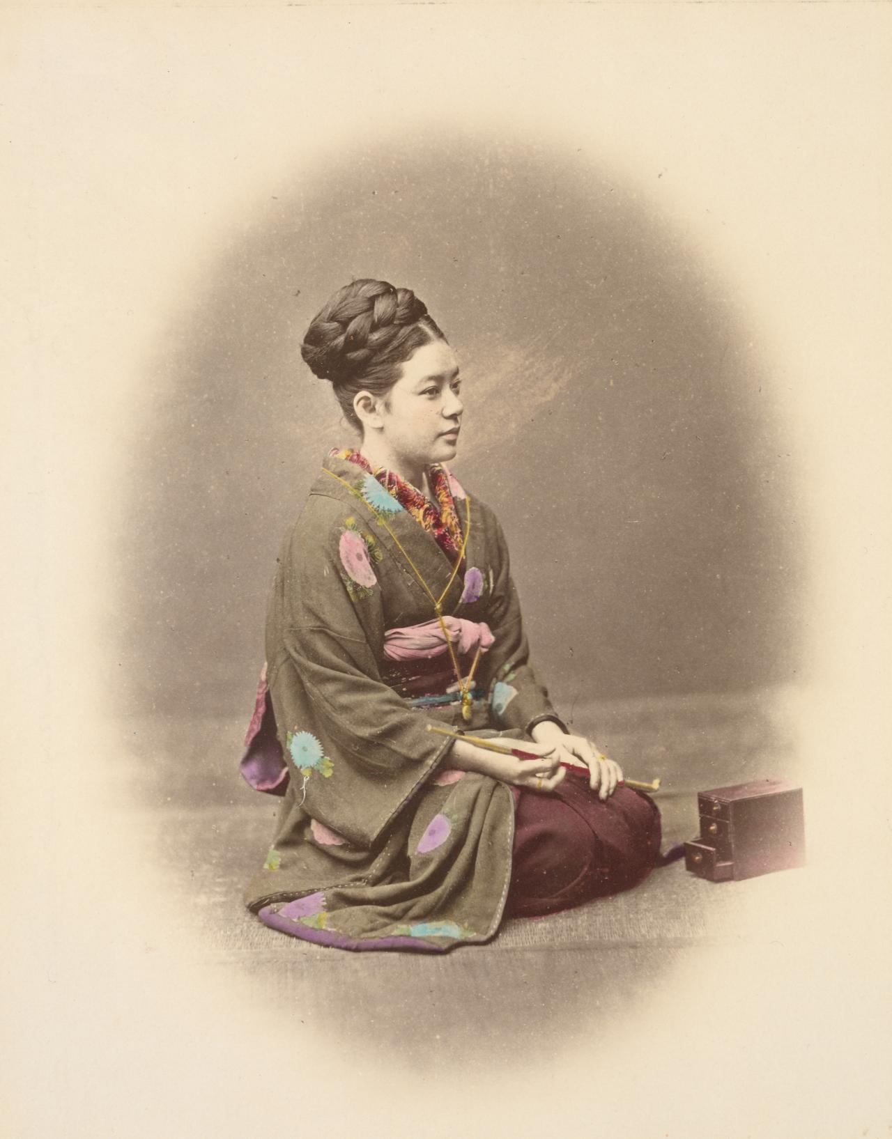 No title (Kneeling woman with pipe and tobacco box)