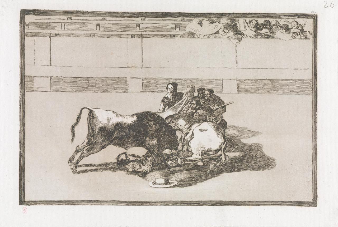 A picador is unhorsed and falls under the bull