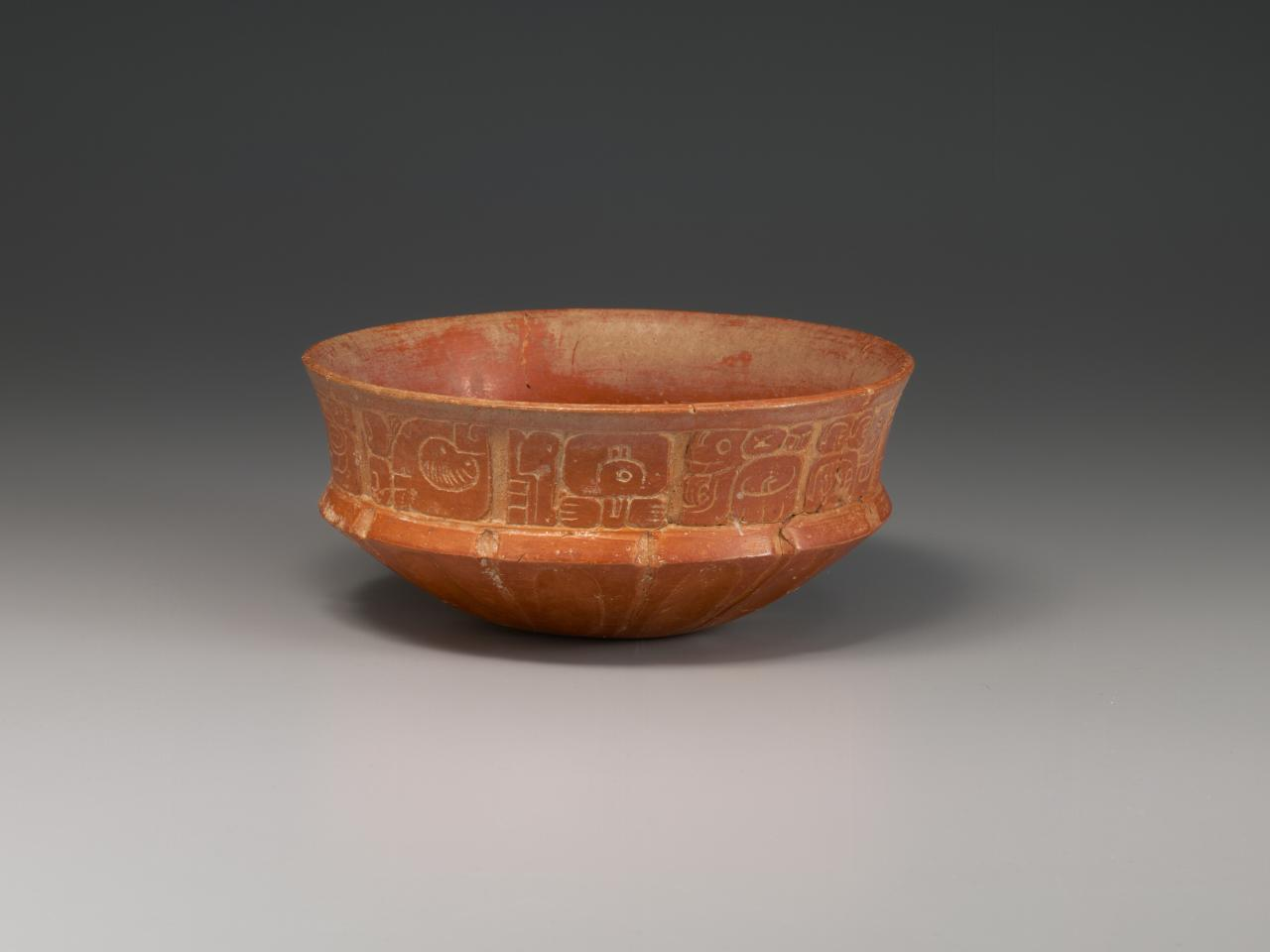 Carved glyph bowl