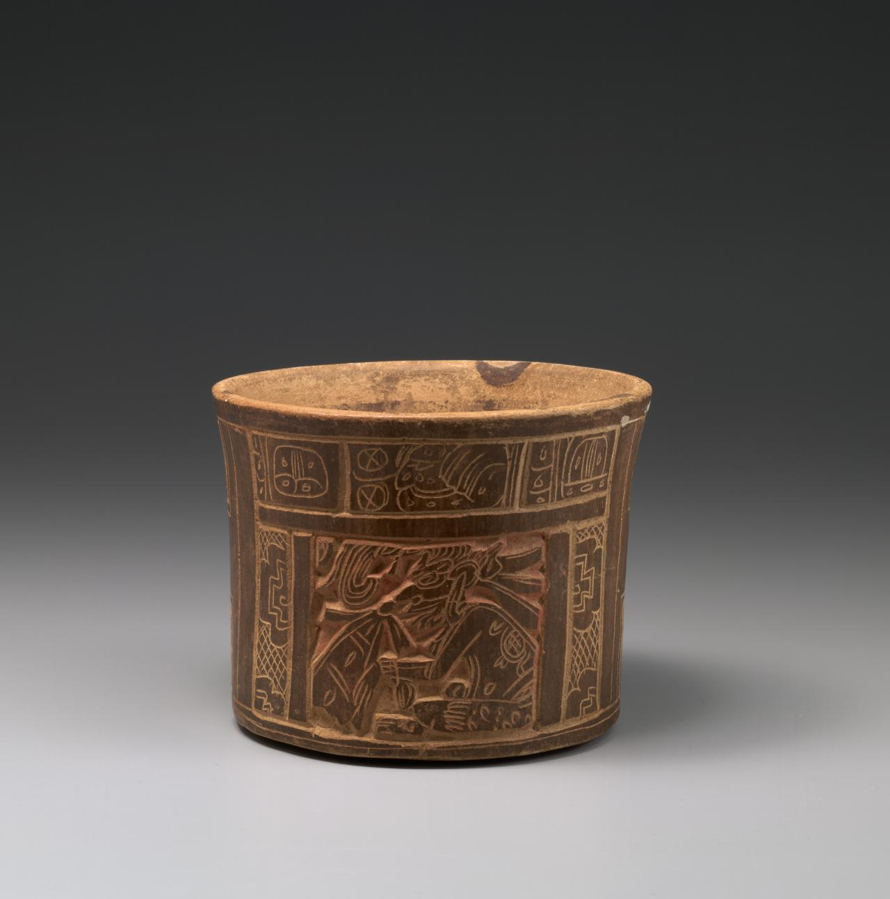 Carved vase with seated ruler and glyph bands