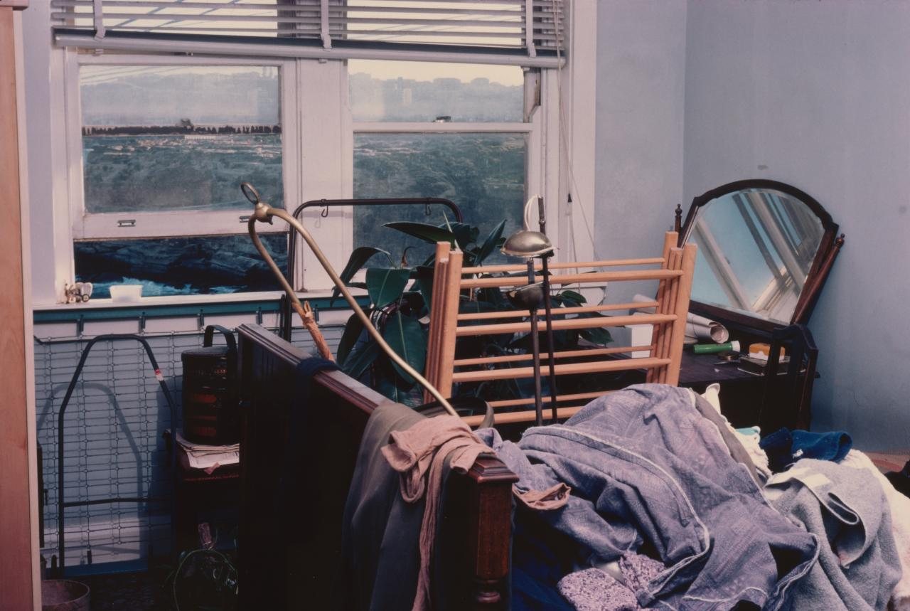 No title (Clothes horse and clothes on bed)