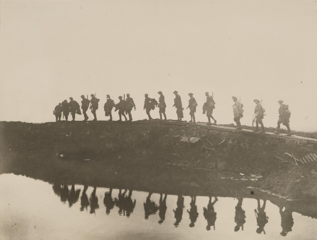 No title (Supporting troops of the 1st Australian Division walking on a duckboard track)