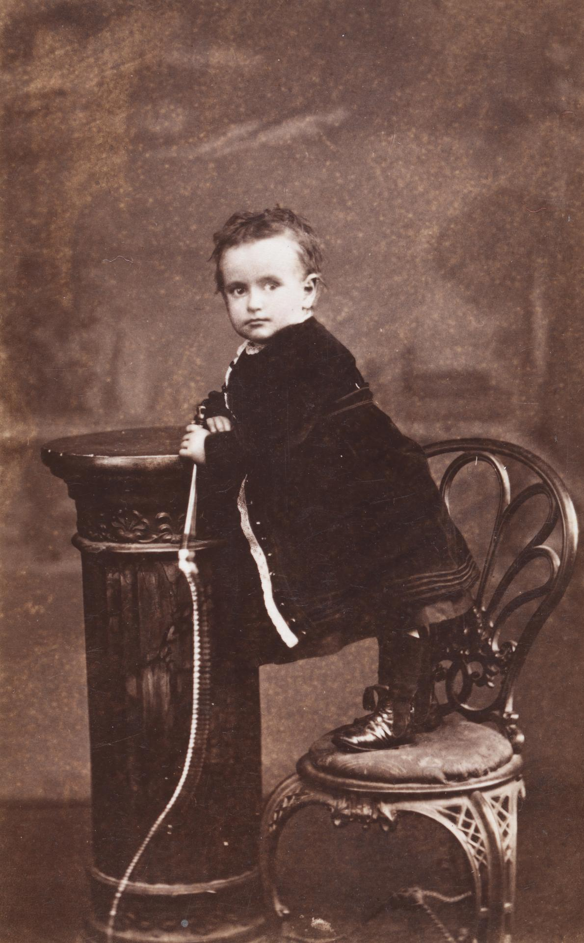 No title (Child standing on a chair and holding a whip), carte-de-visite