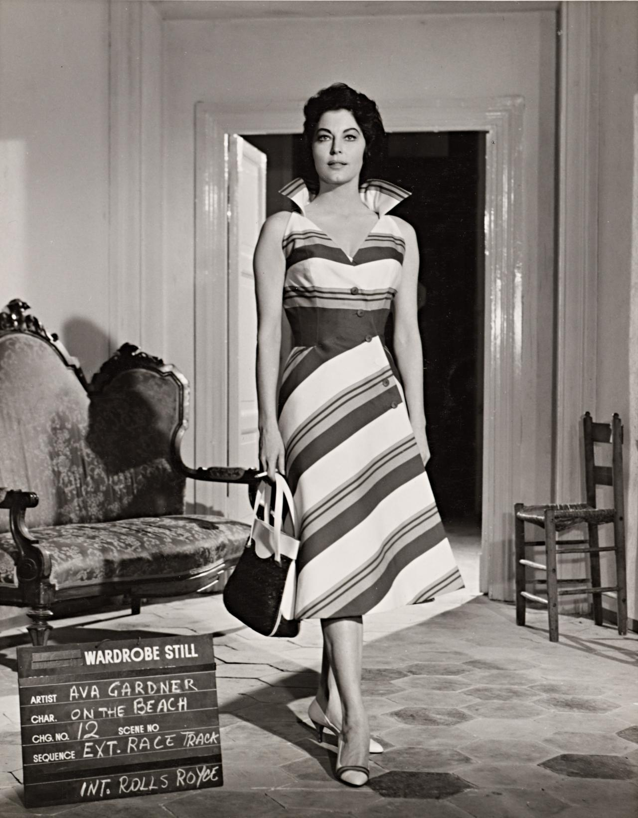 No title (Ava Gardner in wardrobe still for On The Beach: Race track and Rolls Royce)