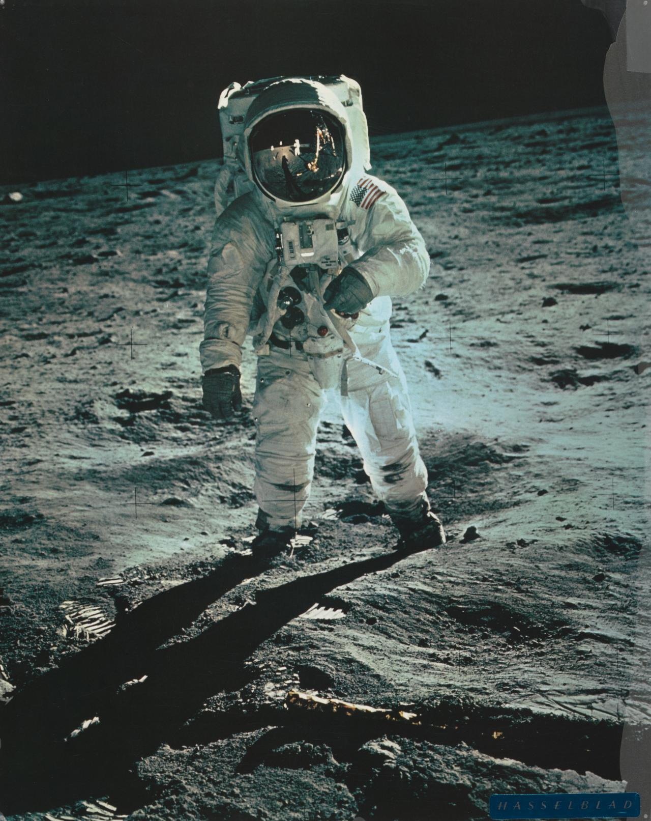 Edwin Aldrin on moon, Armstrong and module reflected in visor, July 1969