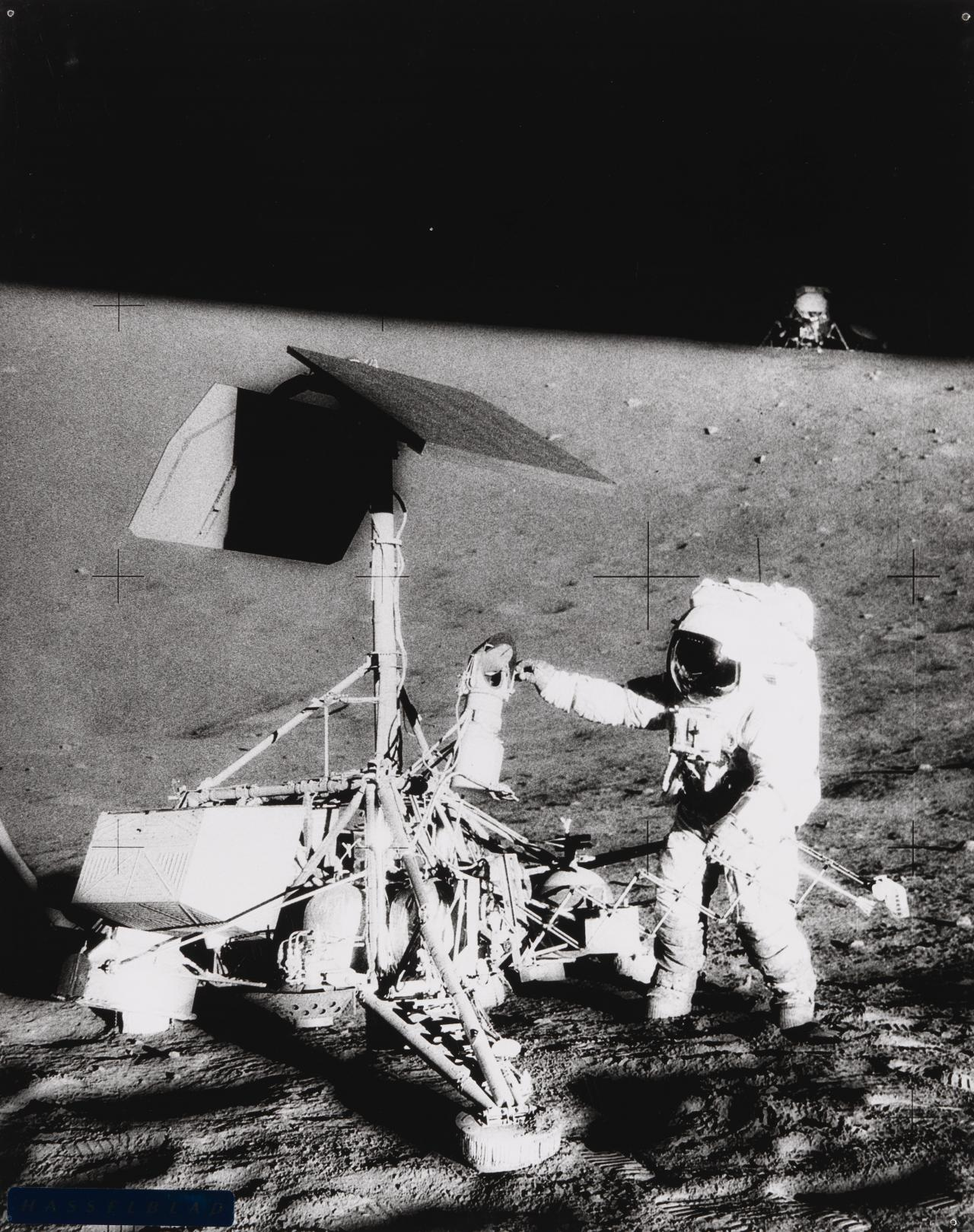 Astronaut inspecting Surveyor 3, Unmanned craft resting on moon since April 1967