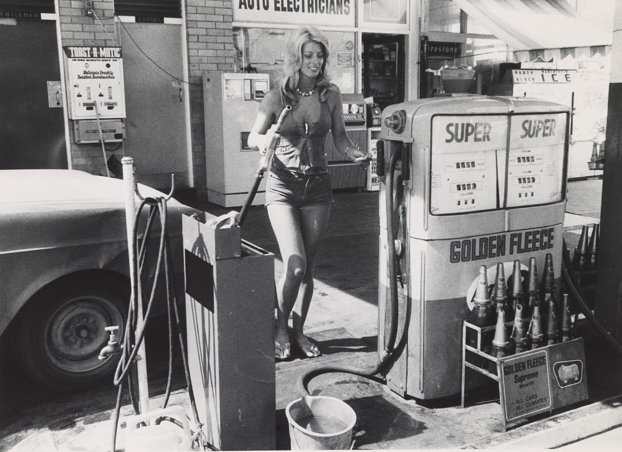 Female petrol pump attendent